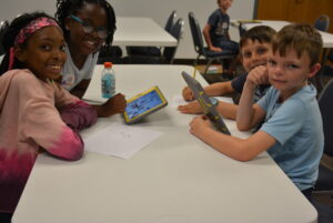 CEISMC STEAM Workshop Image- youth work together to build a project.